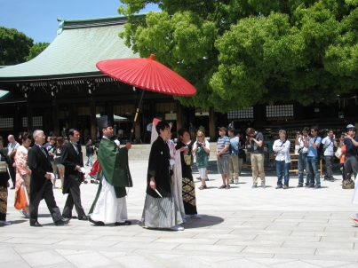 A glimpse of old Japan. Couples walk through the shrine before their wedding vows.